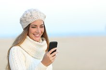 Woman in winter using a smart phone.jpg