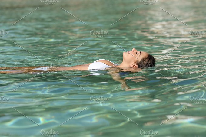 Woman on holidays relaxing and bathing in a tropical beach.jpg - Holidays
