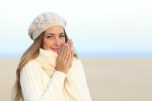 Woman warmly clothed in winter rubbing hands.jpg