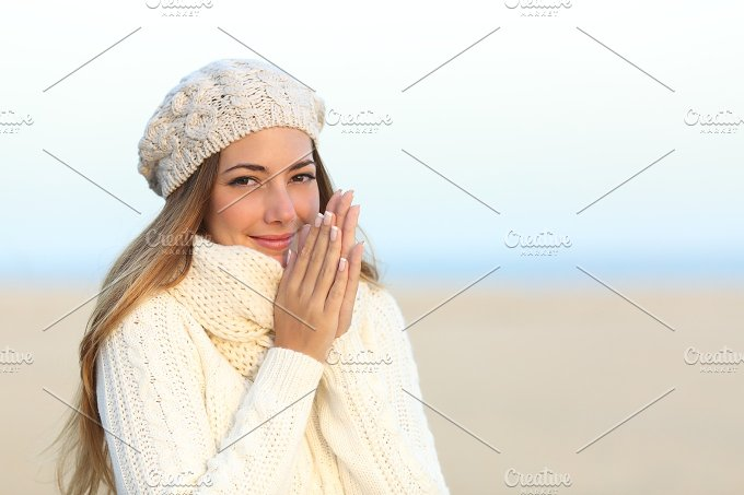 Woman warmly clothed in winter rubbing hands.jpg - Beauty & Fashion