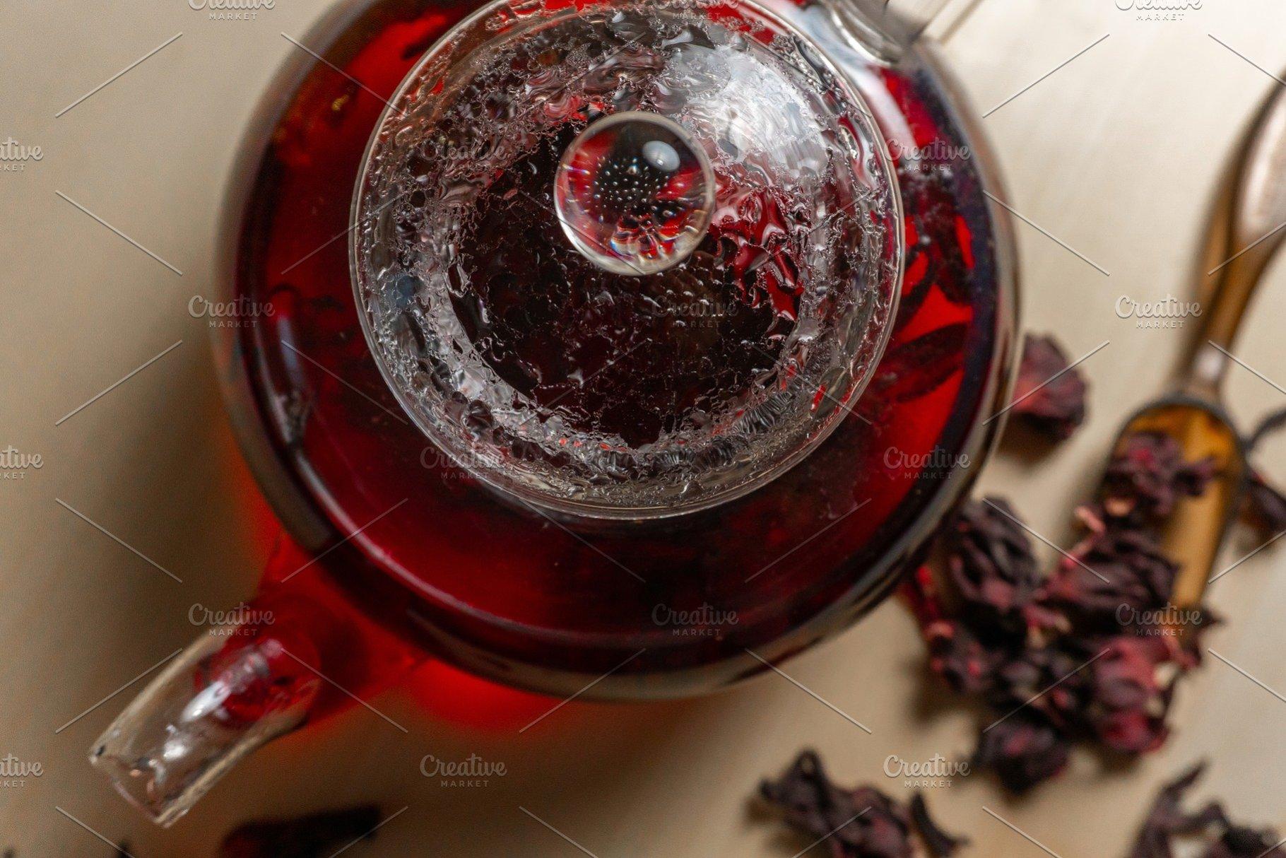 Red egyptian karkade tea in teapot