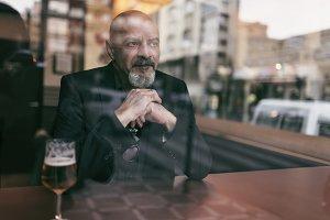 Mature man in a cafe enjoying a rela