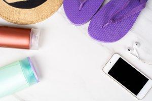 Smartphone, flip-flops, sunscreen an