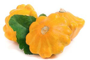 three yellow pattypan squash with