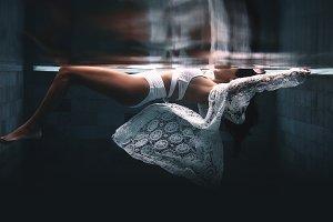 Beautiful woman swimming underwater