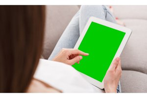 Young woman using tablet device with