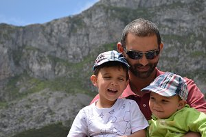 Father and sons in nature.