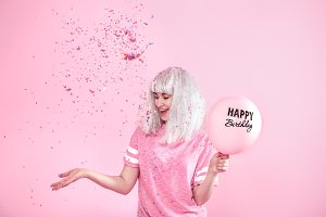 Funny girl with balloons and confeti