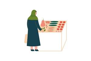 Muslim Woman in Hijab Buying