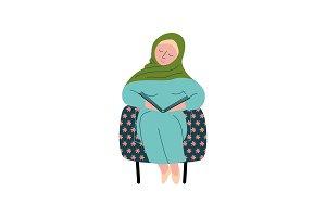 Muslim Woman in Hijab Sitting in