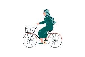 Muslim Woman in Hijab Riding Bike