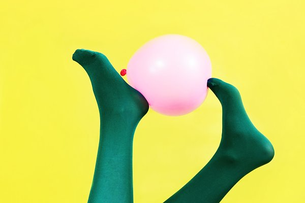 Abstract Stock Photos: NanihtaCreative - Green legs of a woman holding a pink