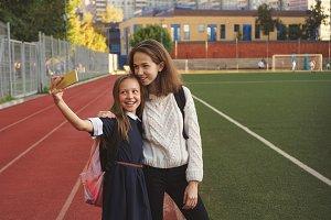 Sisters take selfie on sports field