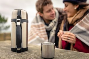 Metalic cup and thermos outdoors