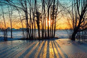 Sunset on iced pond