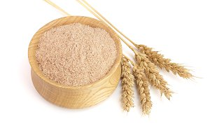 Pile of wheat bran in wooden bowl