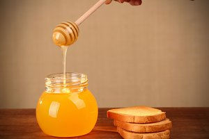 Pot of honey and rusks