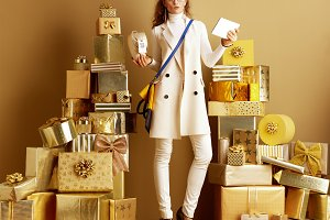 fashion-monger holding product with