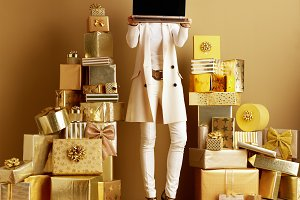 fashion-monger holding laptop blank