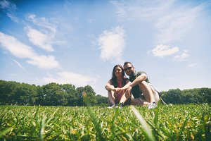 Couple sitting on the grass in Centr