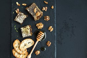 Honeycomb, walnuts & bread slices