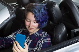 Teenage girl texting while driving