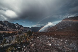 Storm and double rainbow, mountains