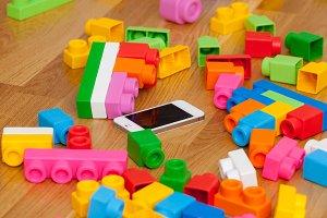 Smartphone on the parquet floor betw