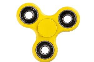 Yellow Fidget Spinner on white backg