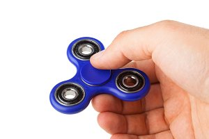 Playing with a blue Fidget Spinner