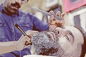 customer on a beard shaving session