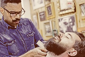 customer on a beard shaving session