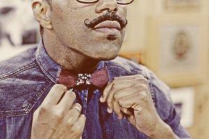 man adjusting his bow tie