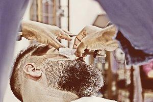 shaving a beard with a razor