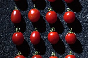 Cherry tomatoes on black background