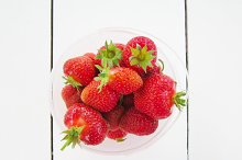 Red strawberry on white table