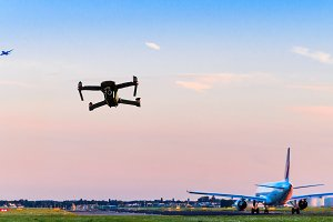 Unmanned drone flying near runway