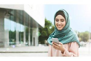 Muslim woman in hijab using