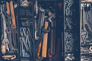 Old tools in a box. Top view