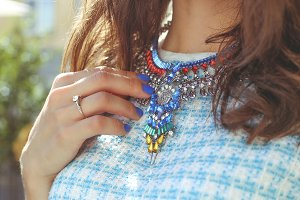 Stylish woman with necklace