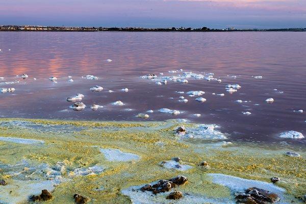Holiday Stock Photos: José Juan Noguerón  - Saline shore in evaporation at sunse