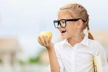 portrait of schoolgirl with apple