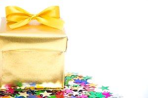 Golden gift box and confetti