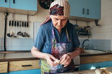 Grandmother cooking by  in People