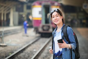 Asian woman traveling with mobile ph