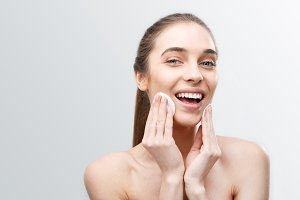 Woman Pampering with Cleaning Pad