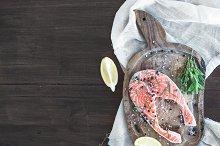 Raw salmon steak with fresh herbs