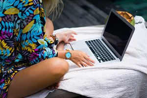 Woman freelancer works on a laptop