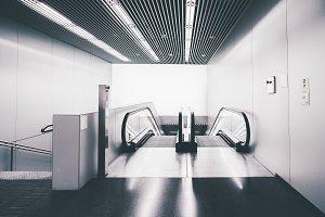 Modern escalator moving downstairs