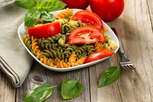 Pesto dish with tomato and basil